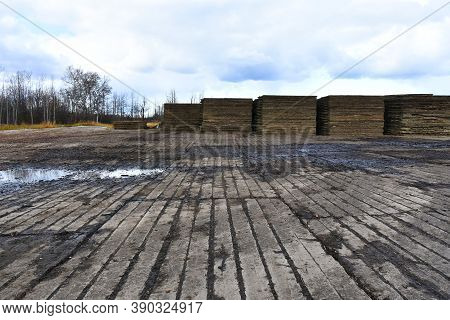 An Image Of Wooden Swamp Mats Used To Create Temporary Road Access And Preserve The Environment.