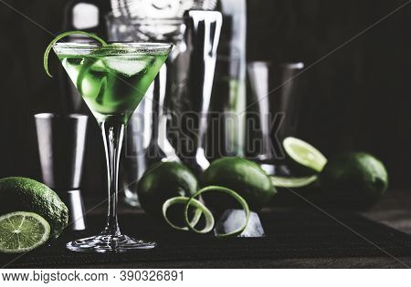 Green Alcoholic Cocktail Martini Glass With Dry Gin, Vermouth, Liquor, Lime Zest And Ice, Bar Tools,