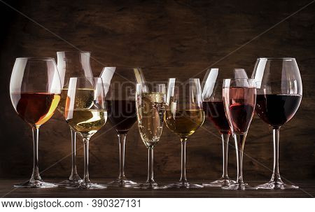 Wine Tasting Concept, Still And Sparkling Wines. Red, White Wine, Rose And Champagne In Wine Glasses