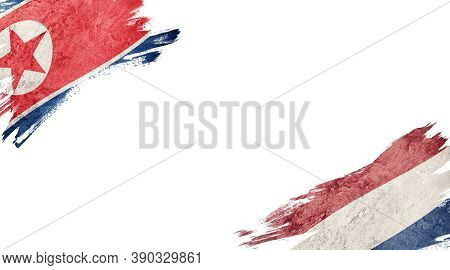 Flags Of North Korea And Nederland On White Background