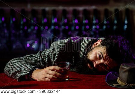 Upset Bearded Man Drinker Alcoholic Sitting At Bar Counter With Glass Drinking Whiskey Alone. Sad De