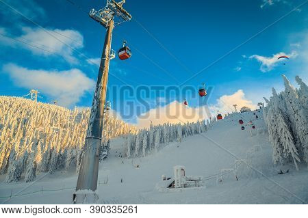 Amazing Winter Landscape With Snowy Pine Forest. Stunning Ski Resort With Ski Gondolas And Ski Lifts