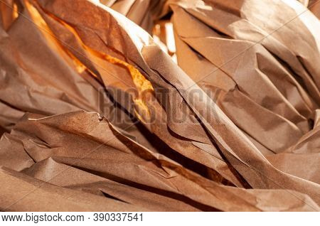Close Up Of Crumpled Strips Of Brown Wrapping Paper As Packaging Material