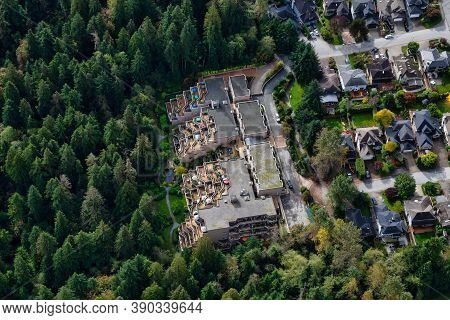 Aerial View Of Residential Homes In A Green Neighborhood During A Sunny Morning. Located In North Va