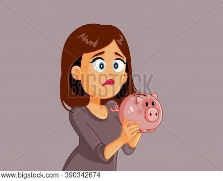 Unhappy Broke Woman Holding A Piggy Bank