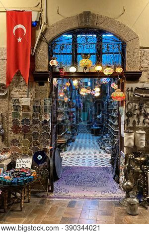 Entrance to the souvenir shop in Antalya, Turkey. Turkish flag, souvenirs and traditional colorful lanterns