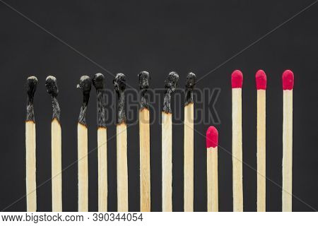 Healthy matches keep social distance with burnt ones. Stop epidemic. Domino effect. Social distancing concept. Preventing measures during coronavirus pandemic. The spread of epidemics.