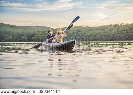 Man And Woman Swims On Kayak In The Sea On Background Of Island. Kayaking Concept.kayaking Concept W