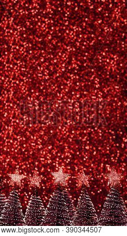 Christmas Tree With Star On Red Glitter Swirly Sparkling Lights Festive Bokeh Background.new Year Ho