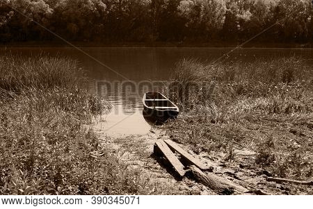An Old Fishing Boat Stranded On The Bank Of The Don River. Black And White Picture Of A Boat In The