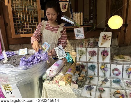 Seoul, South Korea -  April 30, 2017. A Korean Girl Sells Dried Lavender At Bukchon Hanok Village. L