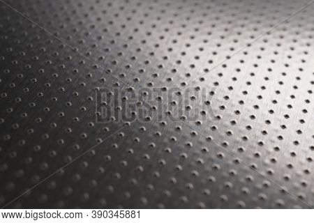 Industrial Metal Background. Dark Wallpaper. Perforated Aluminum Surface With Many Holes. Their Rank