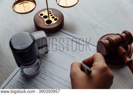 Notary Man Approves The Document Close-up. Notary Public Tools