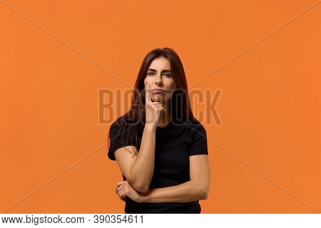 I Have No Idea. I Don't Know What To Do. Attractive Caucasian Woman In Black T-shirt Looks Pensively