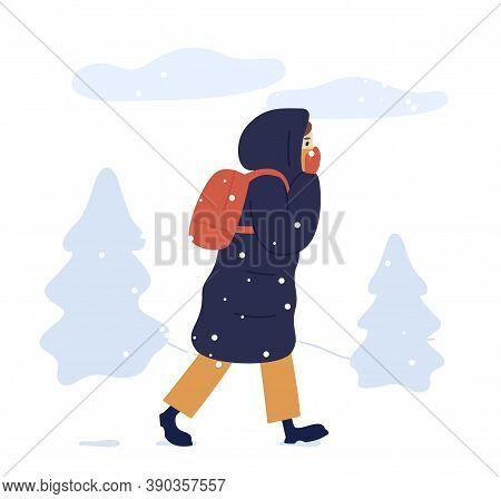 Young Woman In Warm Seasonal Outwear Walking In Winter Park. Female Character In Long Down Jacket Wi