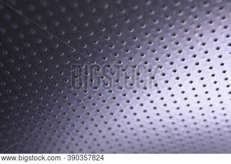 Dark Metallic Wallpaper. Tinted Violet Or Purple Background. Perforated Aluminum Surface With Many H