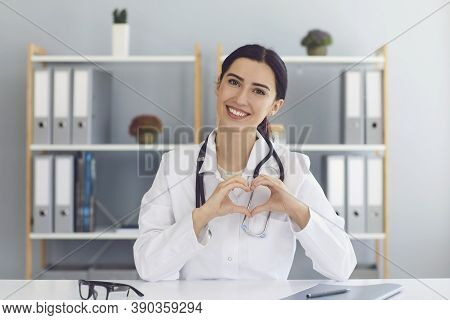 Female Doctor Showing Heart Gesture Indoors. Cardiologist Communicating Online. Cardiac Health, Char