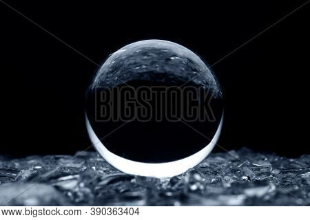 Abstract Glass Ball In Blue. A Crystal Ball With Blurry Pattern. Glass Bal In Blur.