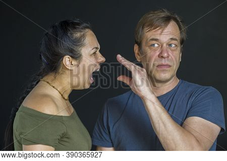 A Woman Screams At A Man Who Teases Her .the Concept:family Quarrel, Conflict Between People, Suspic
