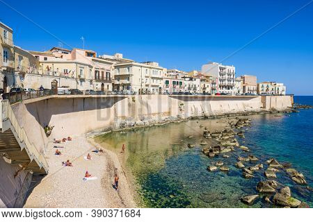 Syracuse, Italy - March 11, 2020: Public beach of Ortygia, the historical part of Syracuse, Sicily, Italy