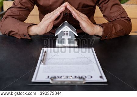 The House Is Covered By The Hands Of A Real Estate Agent To Protect The House For Customers, Homebuy