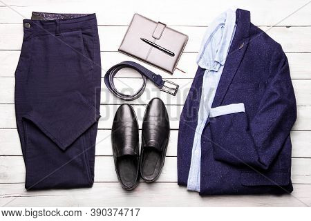 A Set Of Classic Men's Clothing In A Trendy Blue On White Background. Flat Lay.