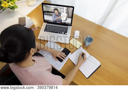 Business Long Distance Video Call, Businessman And Businesswoman Analysis Financial Report Using Vid