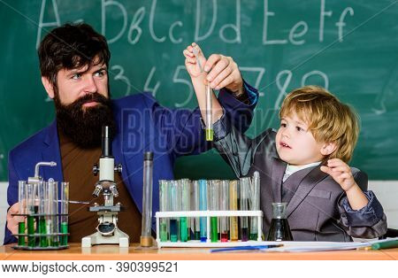 Chemical Invention. School Laboratory. Teacher And Pupil Boy In Chemical Laboratory. Study In Educat