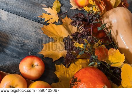 On A Gray Wooden Tabletop On Autumn Yellow Leaves, Autumn Burgundy And Yellow Small Flowers, Yellow