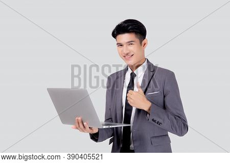 Young Asian Business Man Standing Work On Laptop Computer To Internet Online Isolated On White Backg