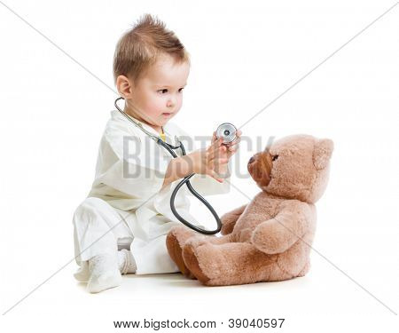 kid or child playing doctor with stethoscope and teddy bear isolated on white