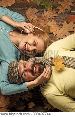 Going Crazy Together. Happy Couple In Love Lying On Fall Background. Excited Fall Couple On Romantic