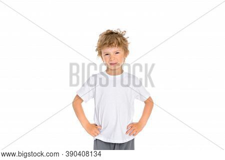 A Little Boy Shows His Displeasure With His Facial Expression And Holding His Hands At His Waist. Ph