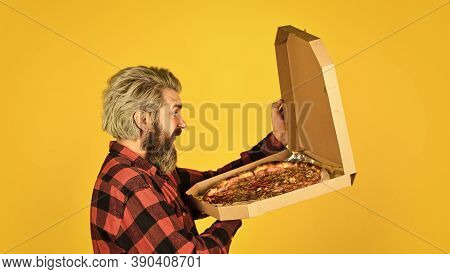 Cooking Food Concept. Giving Food Order And Holding Pizza. Hungry Man Eating Pizza. Fast Food Delive