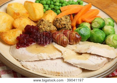 Roast turkey Xmas dinner with traditional trimmings.