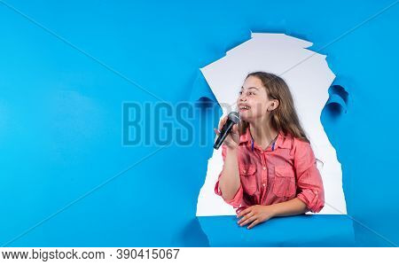 Make Your Voice Louder. Teen Girl Singing Song With Microphone. Having A Party. Happy Kid With Micro