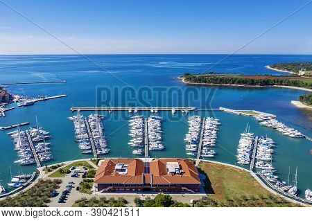 An Aerial Shot Of Coastal City Novigrad With Boats And Yachts In Marina, Istria, Croatia