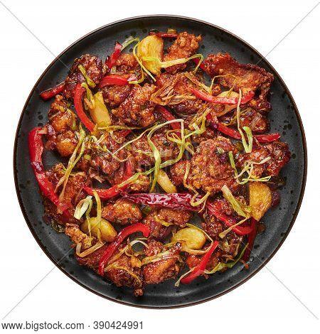 Kkanpunggi Or Korean Spicy Garlic Fried Chicken On Black Plate Isolated On White Background. Kan Pun