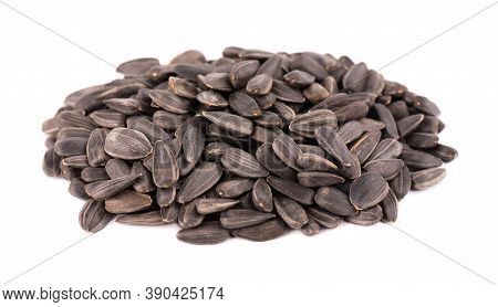 Sunflower Seeds Isolated On White Background. Pile Of Fried Sunflower Seeds.