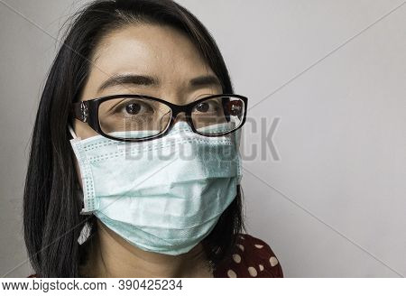 Close Up Face Of Beautiful Asian Woman With Medical Mask, Middle Aged Woman With Short Black Hair, W