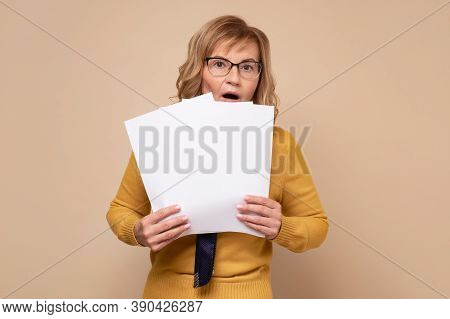 Worried Mature Business Woman Reading Documents. Upset Woman Frustrating With Papers.
