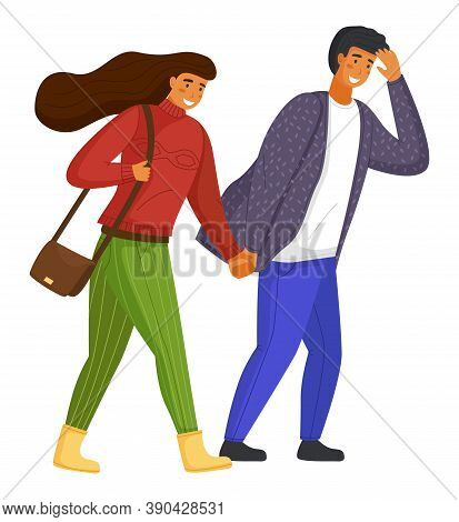 Young Couple Walking, Overcoming Strong Gusts Of Wind. Long-haired Woman In Red Sweater And Green Pa