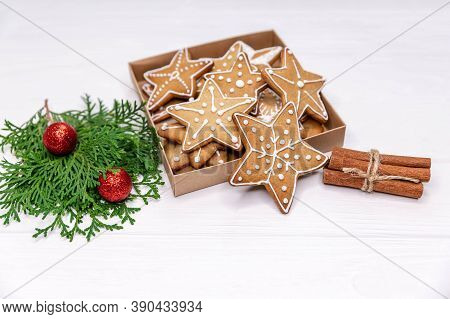 Homemade Sweet Present - Variety Of Christmas Gingerbread Cookies In Box, Oranges, Xmas Tree On Whit