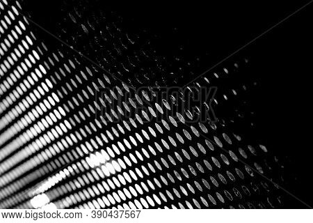 Abstract Black Background In Black And White With Round Slits And Harsh Light.