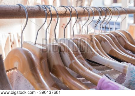 Clothes On Wooden Hangers In Shelf Fashion For Sale Shopfront Store Collection, Retail In Shop Store