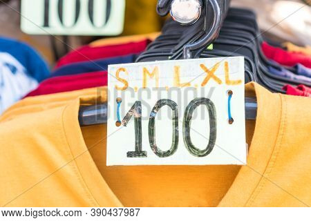 Clothes On Plastic Hangers With Price And Size T-shirt In Shelf Fashion For Sale Shopfront Store Col