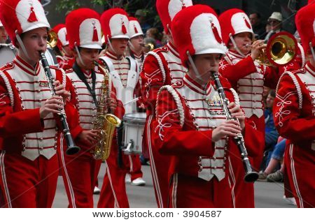 Clarinet & Saxophone Players In Bright Red