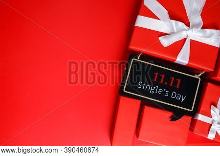 Online Shopping Of China, 11.11 Single's Day Sale Concept. The Red Gift Boxes On Red Background With