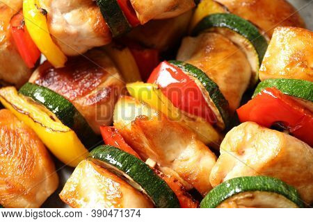 Delicious Chicken Shish Kebabs With Vegetables As Background, Closeup