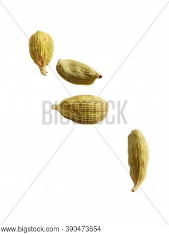 Dry Cardamon Seeds On White Background. Mulled Wine Ingredient